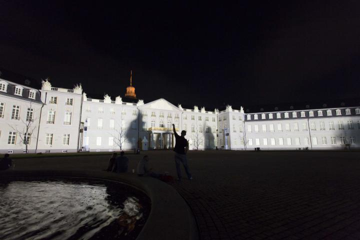 The palace facade within white lights