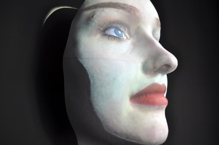 The picture shows a masks face looking upwards.