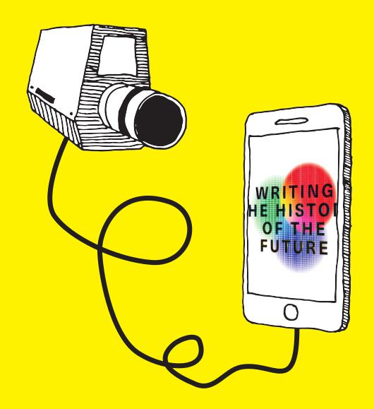 The logo of the exhibition »Writing the History of the Future« can be seen on the screen of a smartphone. To the left of it floats a video camera connected to that smartphone by cable.