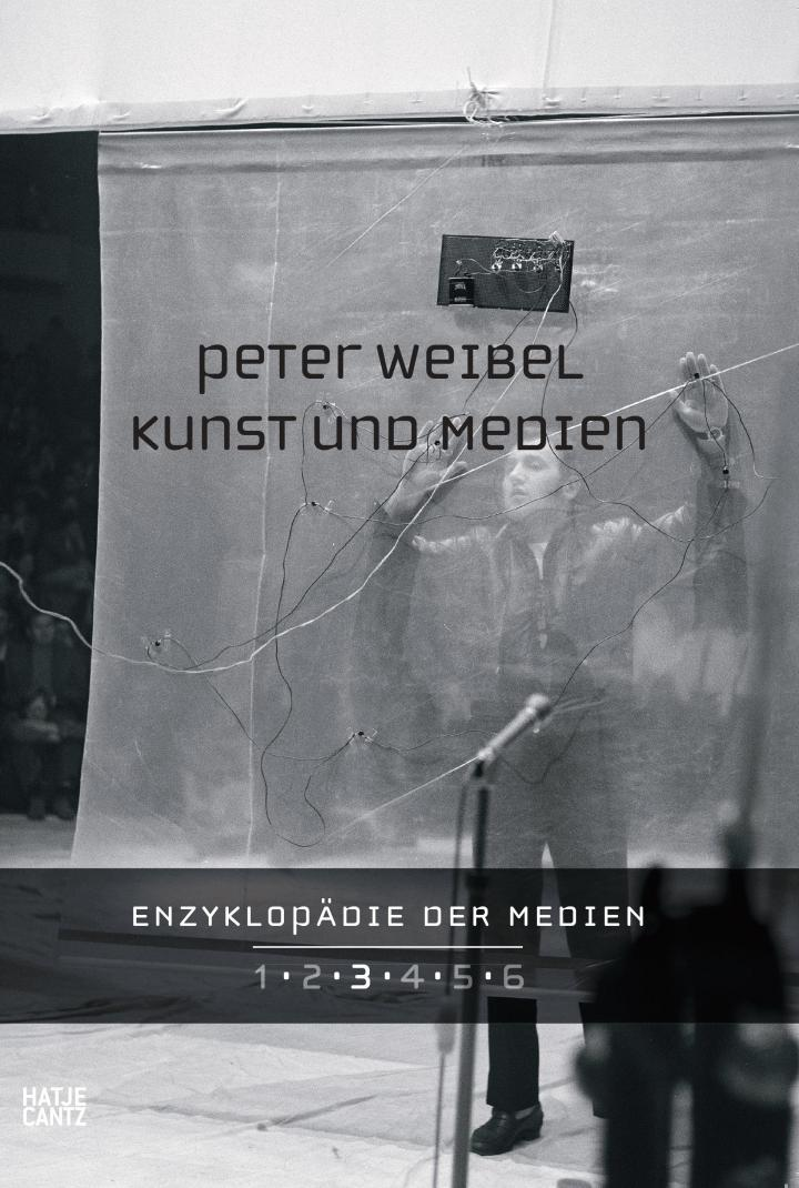 Publication cover: light grey and person with raised arms in the background