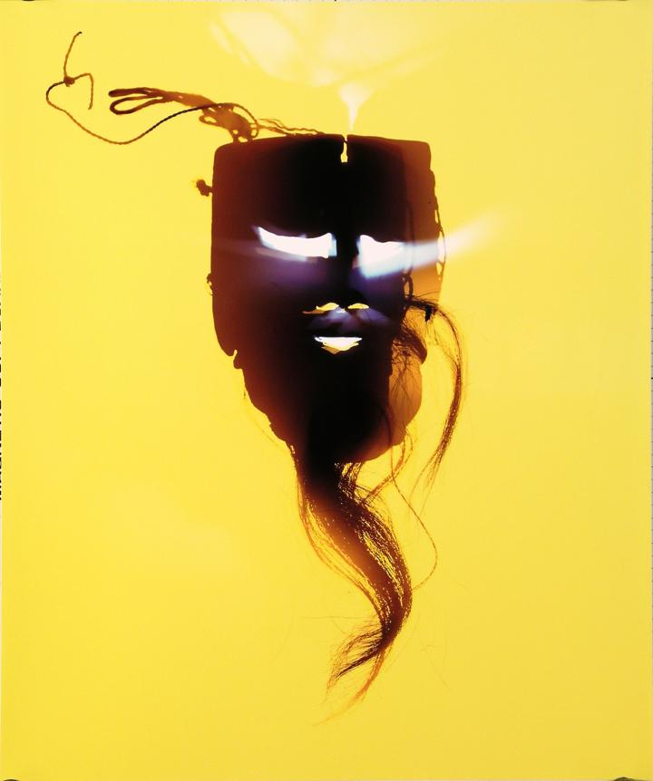 Mask against a yellow background