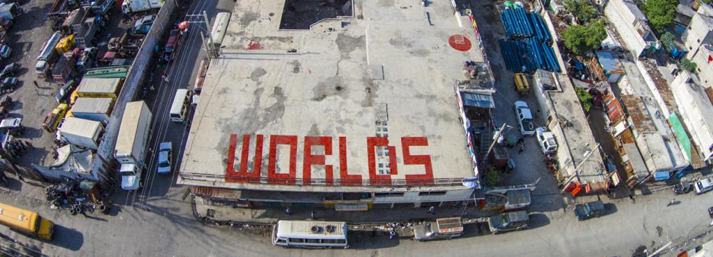 On a roof in red letters: »WORLDS«