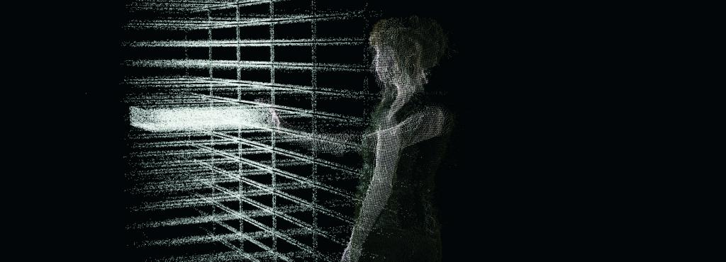 A silhouette of a woman from codes stands in front of a grid of codes.