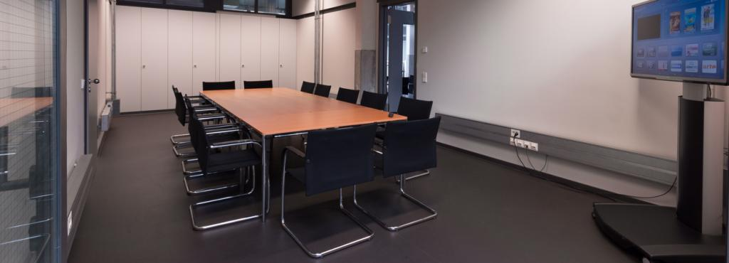 Room with a large table and chairs