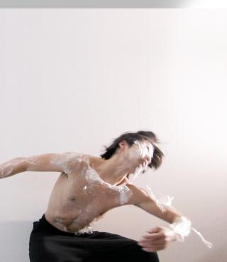 A dancer wrapped in plastic wrap