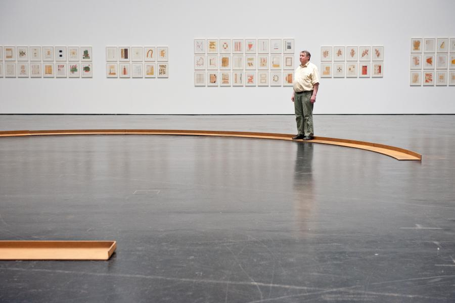 The photo shows Franz Erhard Walther in front of some of his works