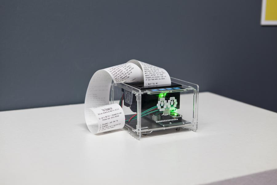 A see-through printer prints on a long piece of paper