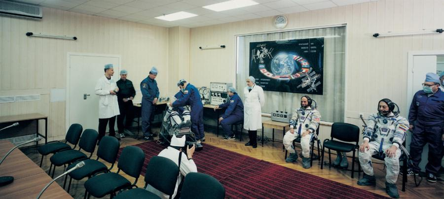 A conference room. There are several astronauts and doctors.
