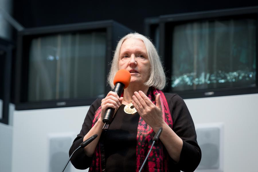 A woman talking into a microphone