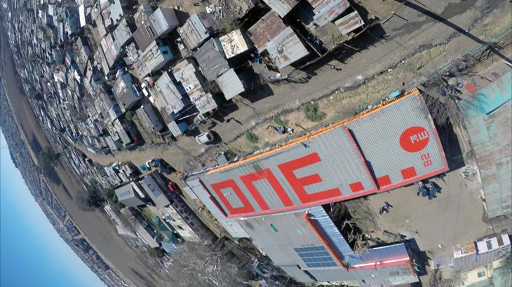"""The word """"one"""" in red letters on a roof"""
