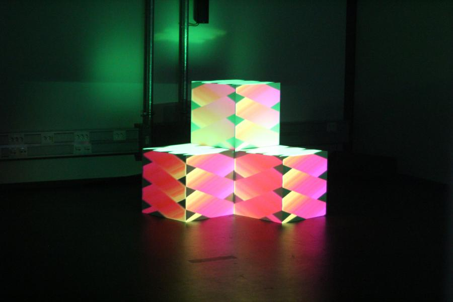 Three stacked colored cubes