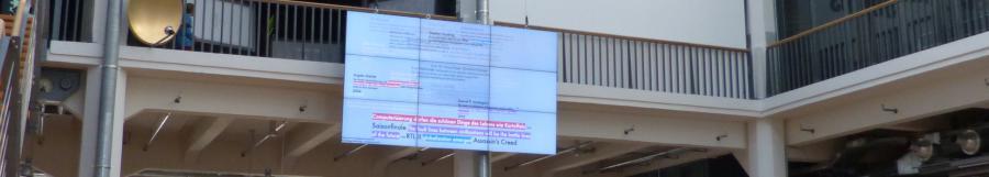 Eine große Leinwand mit verschiedenen Texten