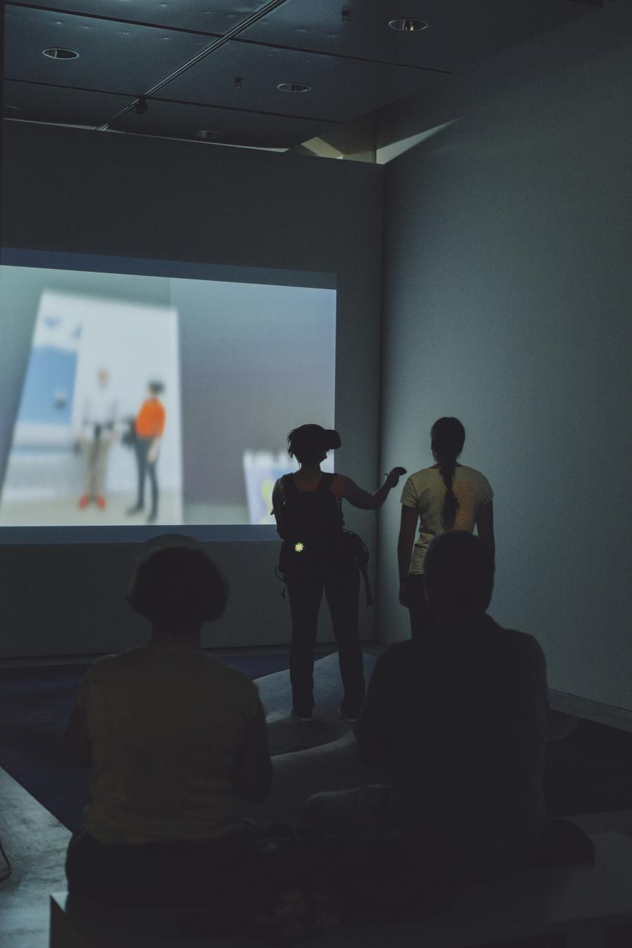 The picture shows a visitor wearing VR glasses