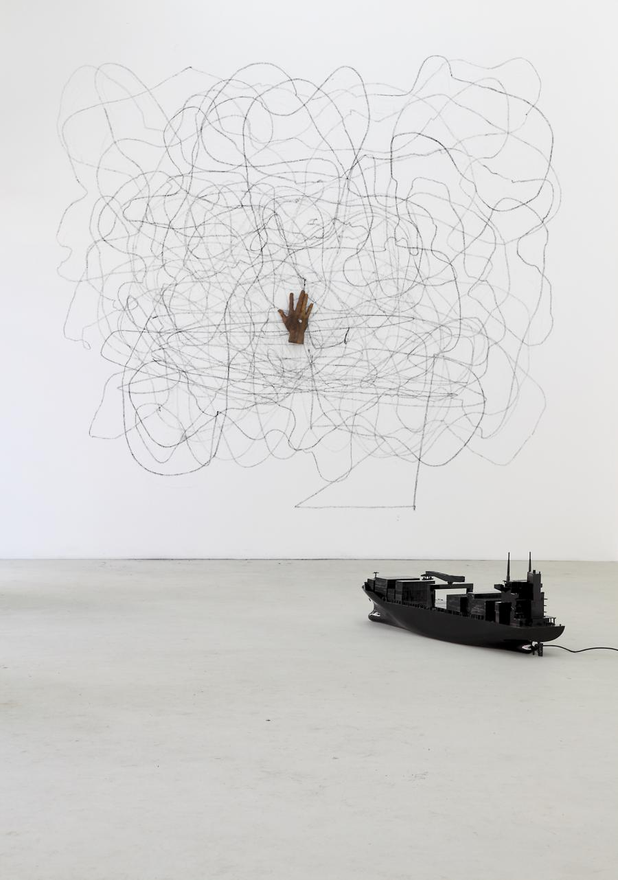 Installation with a boat and hand