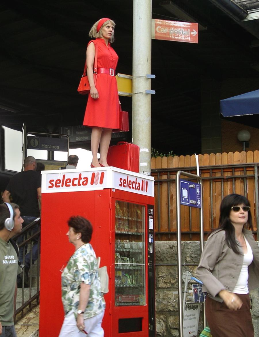 Woman standing on a candy box