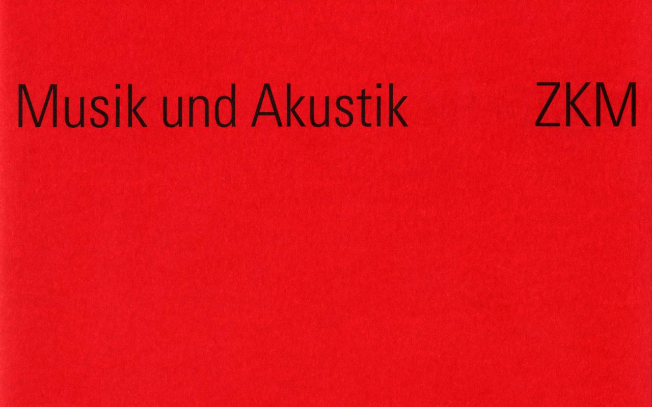 Red cover with black writing.