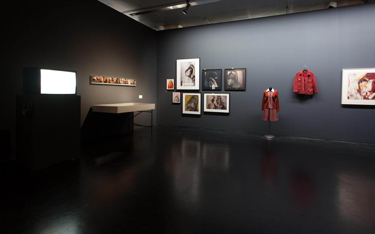 Images and a dress on the wall