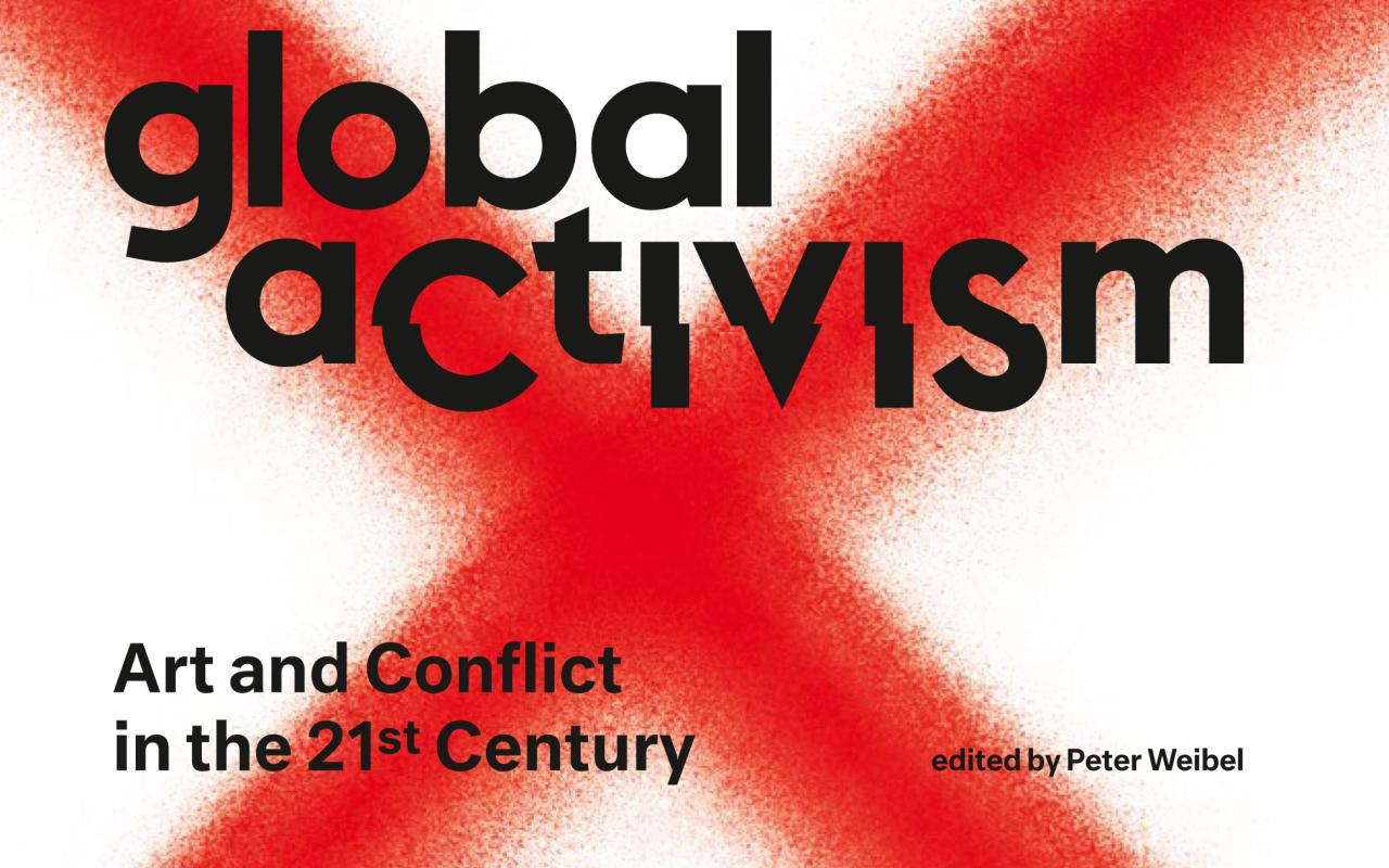 """The book cover of """"Global Activism"""" shows a photo: A man is kneeling in the street with both hands up forming the victory sign. He looks at a force of uniformed men."""