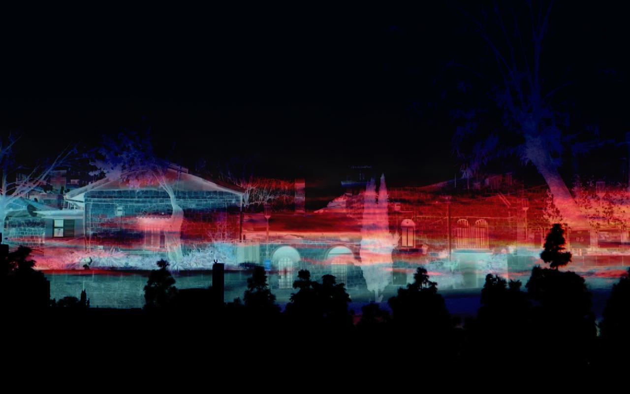 EIne bunte Stadtlandschaft im Hintergrund, schwarze Silhouetten von Bäumen im Vordergrund