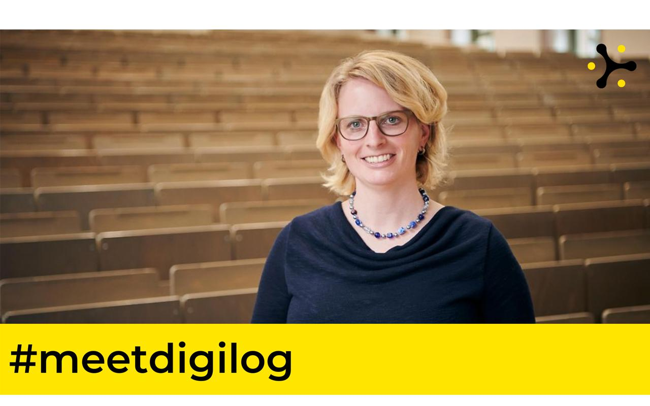"""A photo of Prof. Dr Melanie Volkamer, smiling in a lecture hall, with the Digilog logo and the words """"#meetdigilog""""."""