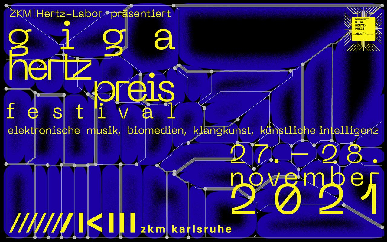 You can see a blue and black poster of the Giga-Hertz Award with gray lines and yellow writing on it.