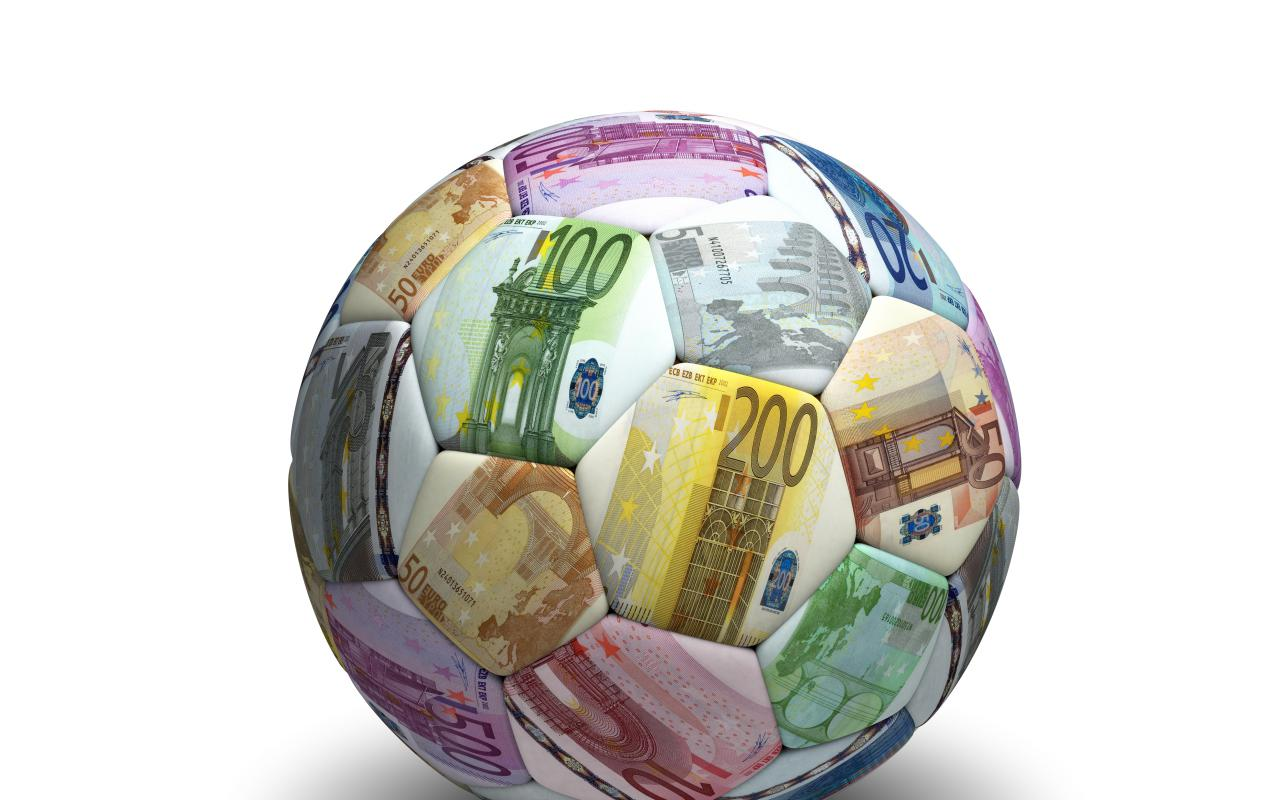 A football with a lot of euro notes on it.