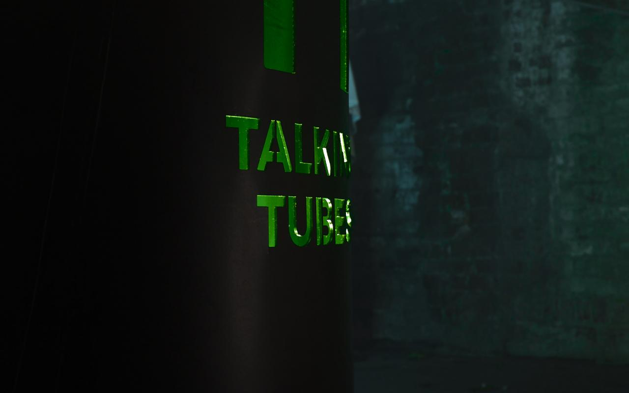 Side view of the control panel of the installation with the inscription »Talking Tubes«