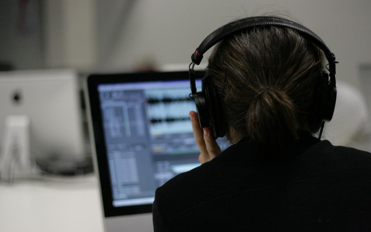 Someone is working with a composing software, that is showing on the computer screen
