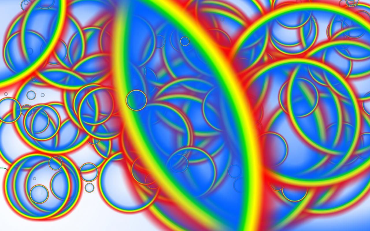 Ein abstraktes Photoshop-Gemälde aus regenbogenfarbenen Ringen.