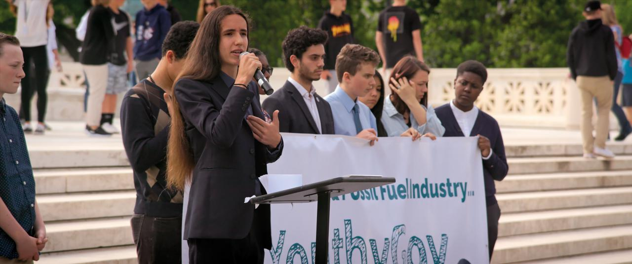 A group of young people gives a public speech for a more environmentally friendly policy