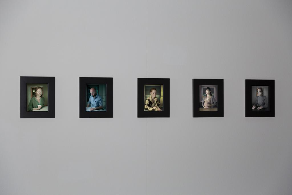 Five individually framed portraits of different persons.