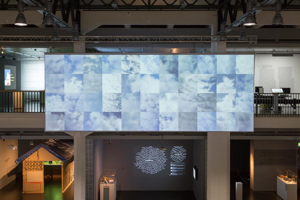 A big screen with various clouds illustration