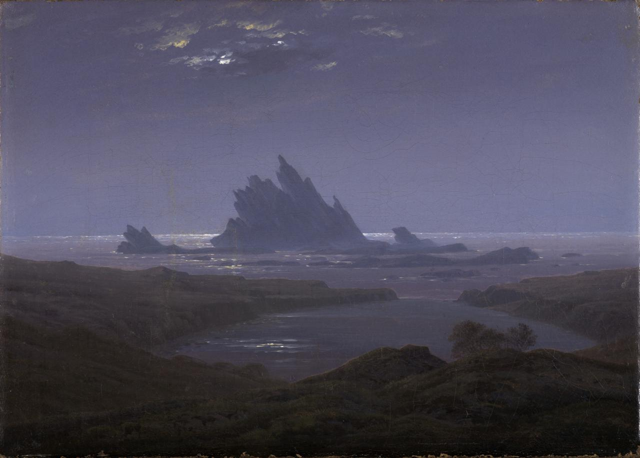 Painting in shades of blue. In the foreground you can see a rocky coast. In the background a rocky reef in the sea.