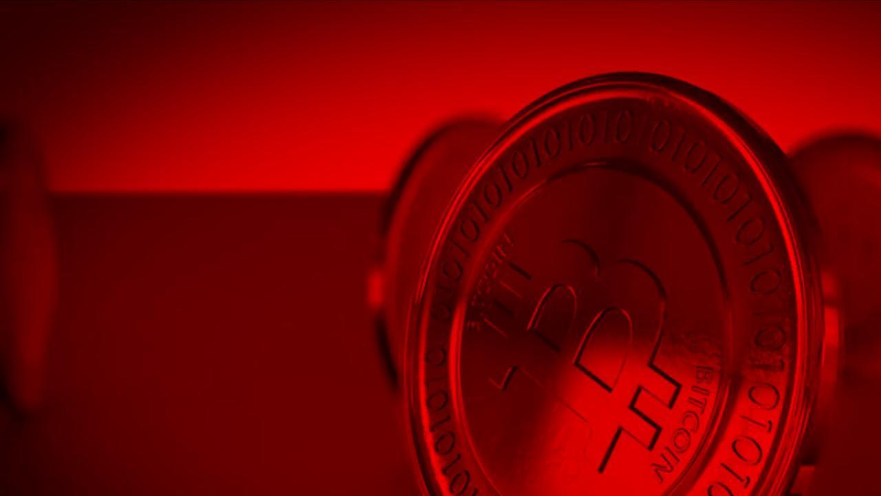 Darstellung einer Münze mit geprägtem Buchstaben B in roten Farben