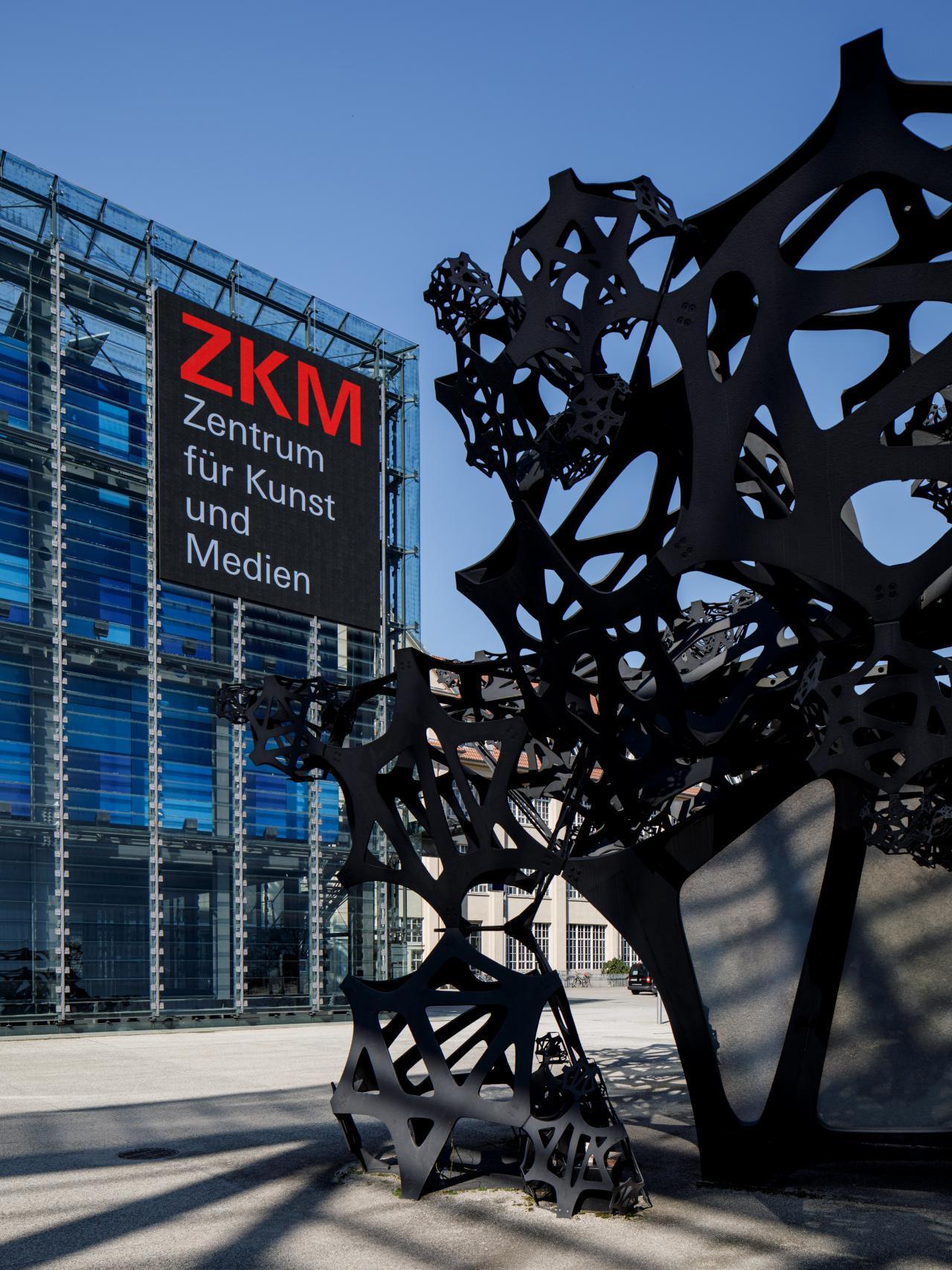 On the left is a part of the ZKM Cube with a video wall, on the right the squiggly architecture of the Sound Pavilion The Morning Line protrudes into the picture.