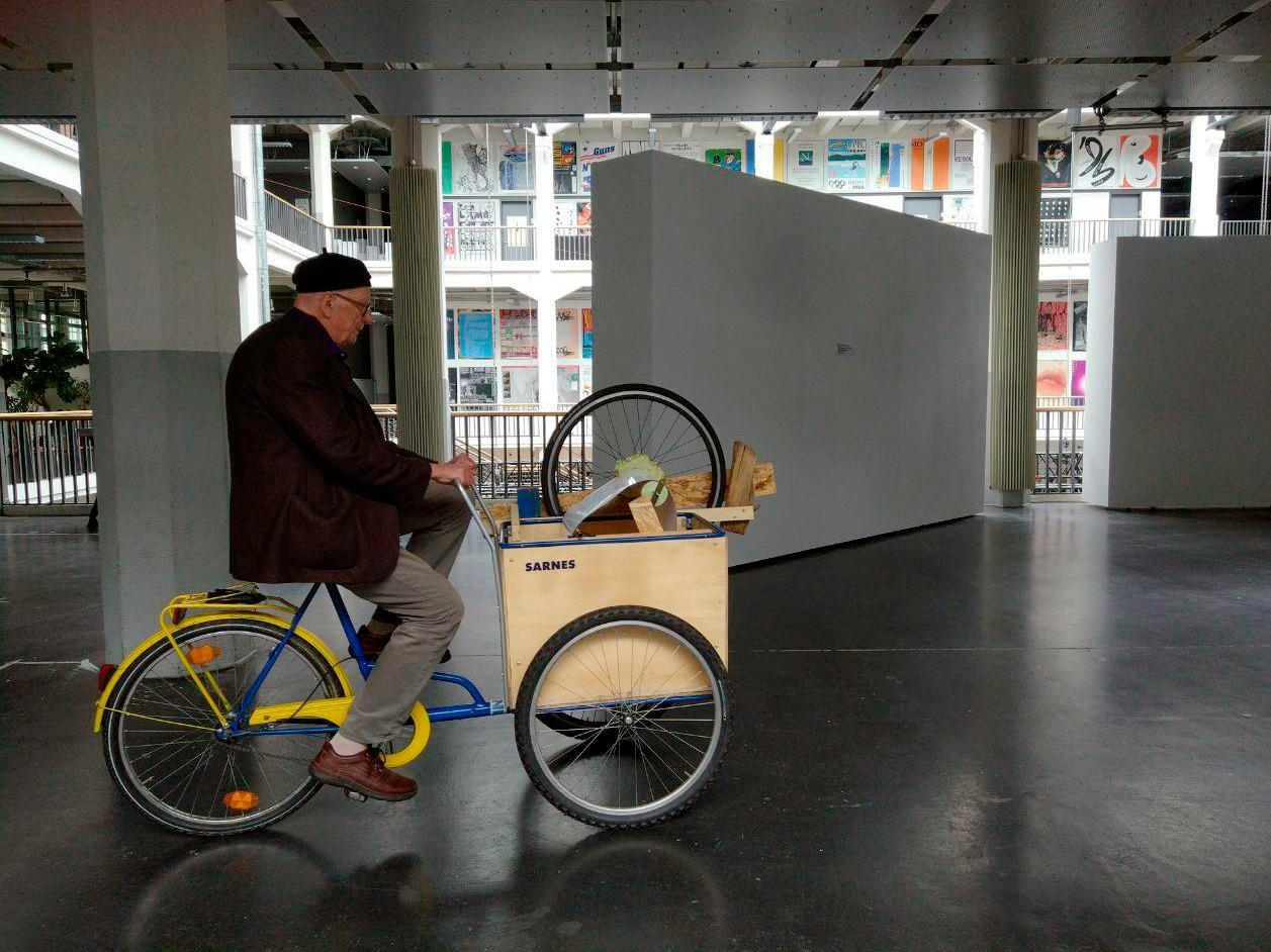 Bruno Latour riding the reading bike.