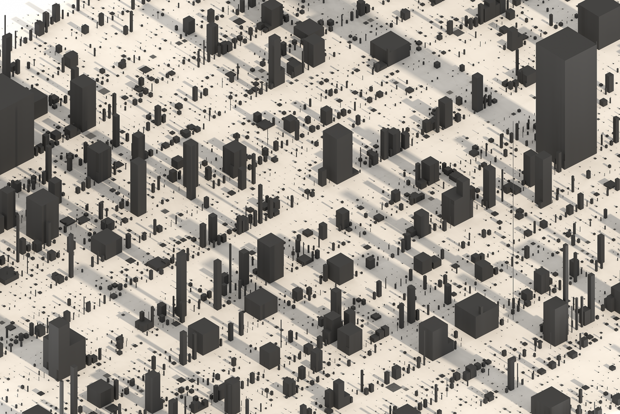Grey cuboids in different sizes on a flat surface. They look like a city of skyscrapers.
