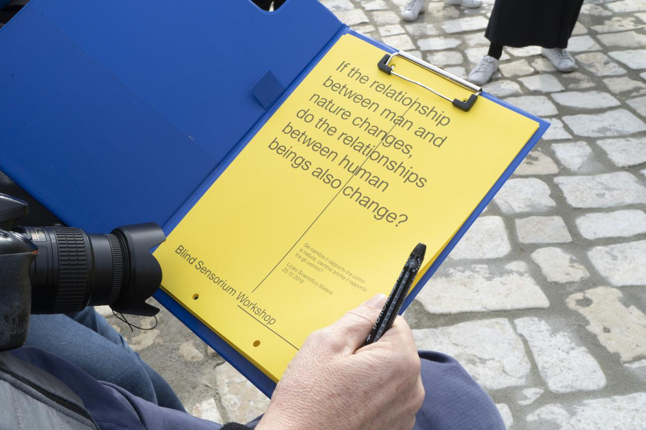 A close-up of a clipboard with a text.