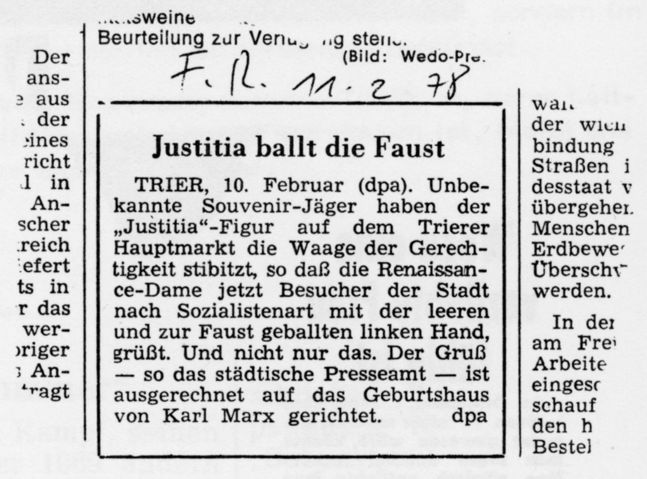 Zeitungsartikel mit der Überschrift: Justitia ballt die Faust