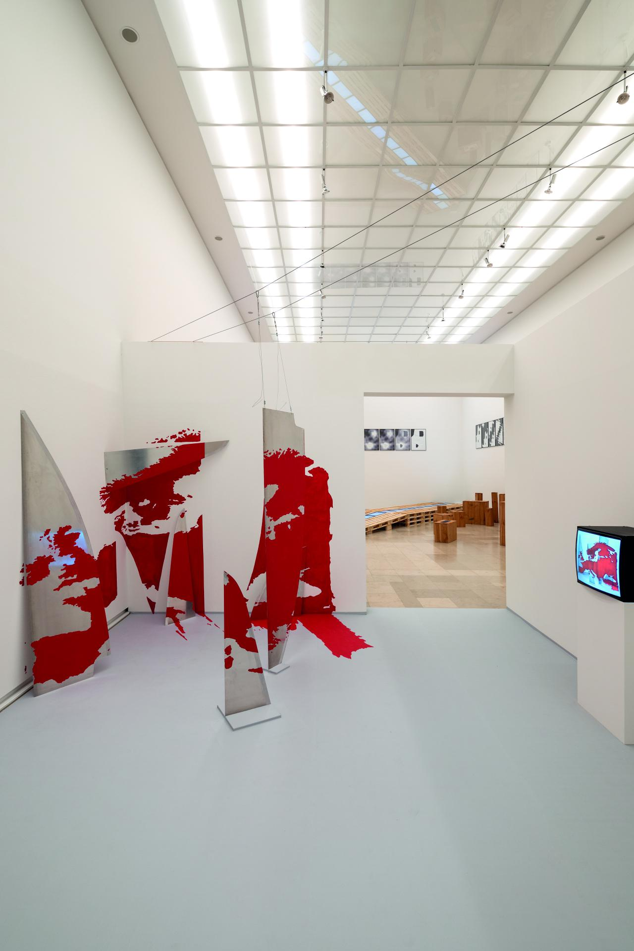 Installation view. A map of the world is grown into the wall in three dimensions.