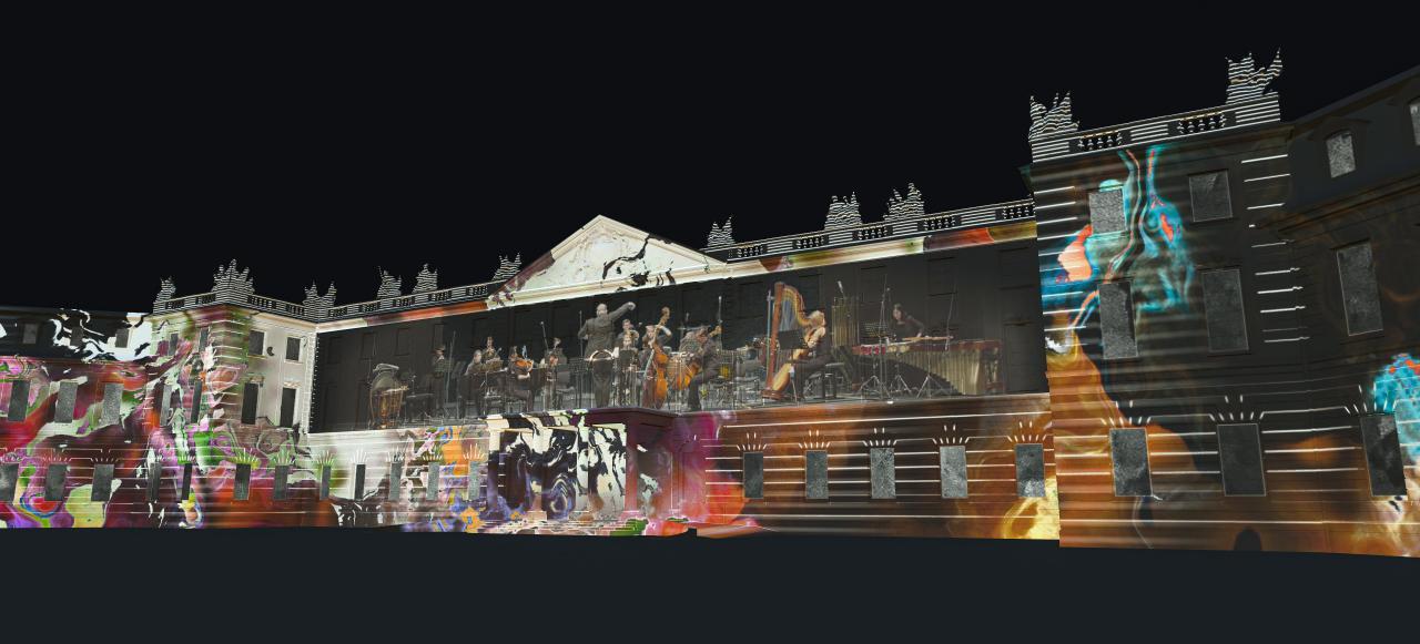Zu sehen ist eine Visualisierung des beleuchteten Karlsruher Schlosses. Projiziert wurde ein Konzert umgeben von Graffitti-ähnlichen Abbildungen