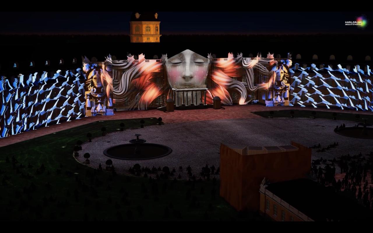 Auf der Karlsruher Schlossfassade ist ein Projection Mapping zu sehen, das in der Nacht leuchtet.