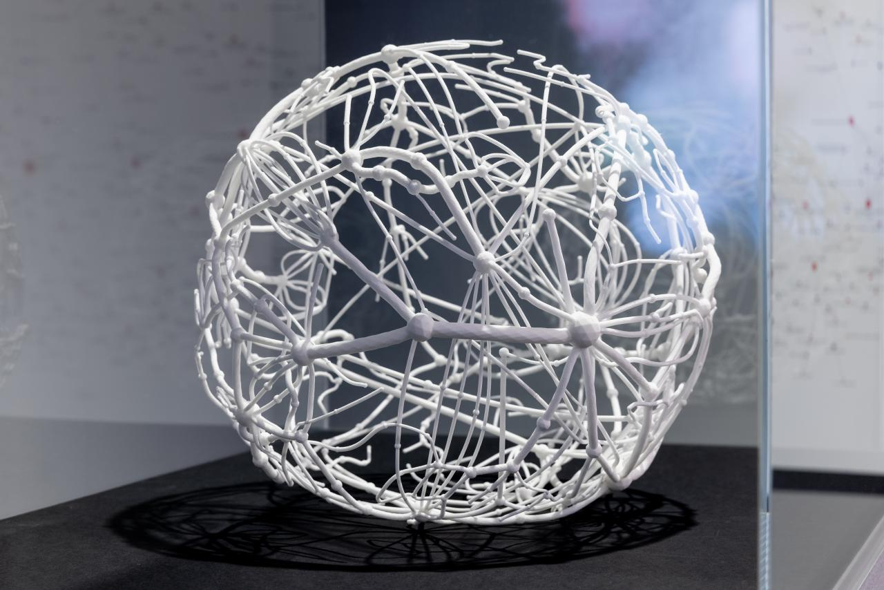A 3D print of a sphere consisting of a tightly branched network.