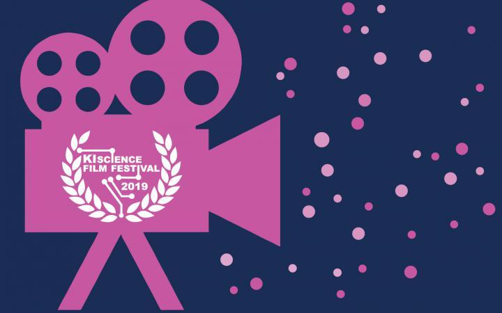 Graphik des KI Science Film Festivals 2019 mit einem rosa Kamera Icon vor einem dunklen Hintergrund.