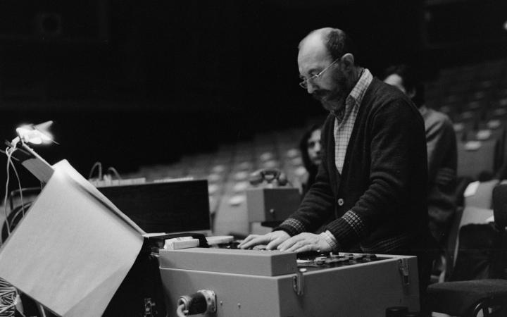 A man standing at a sound mixer