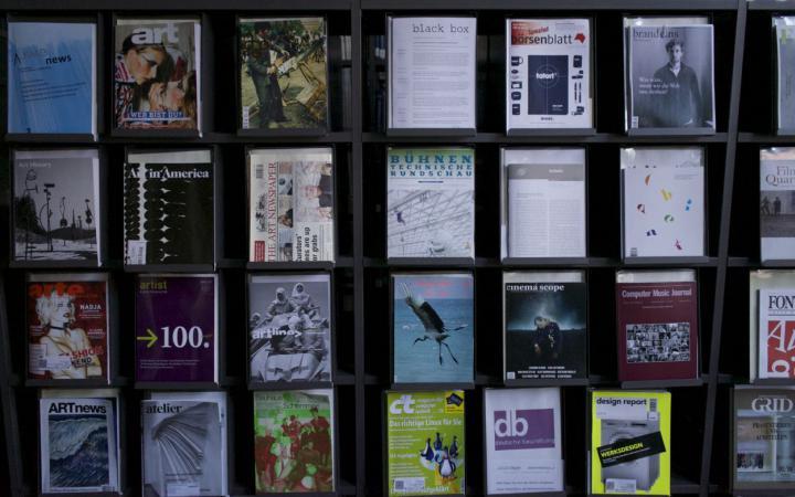 A shelf full of different journals