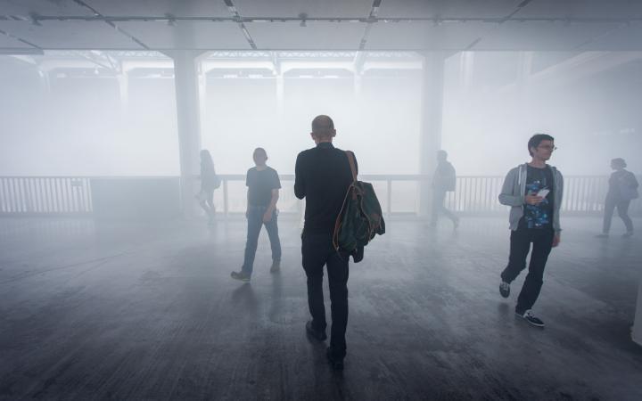 People walking through fog