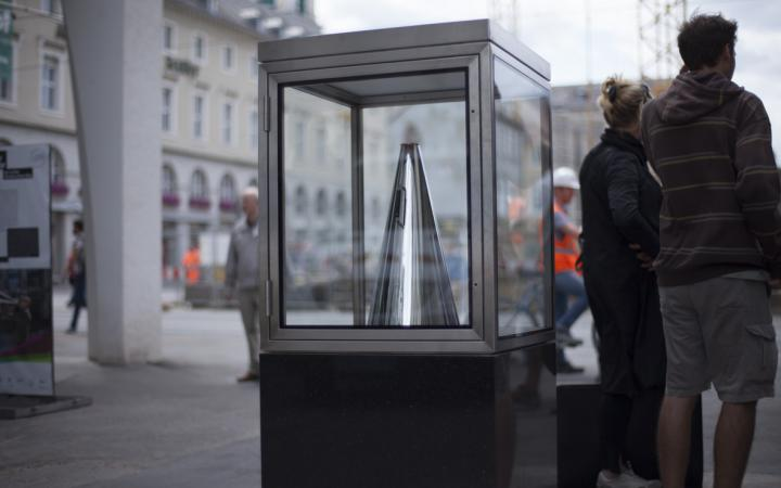 A megaphone in a glass cabinet