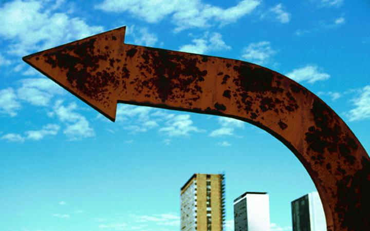 Broad arrow made of copper in front of blue sky