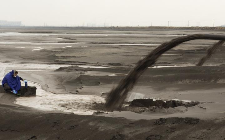 Waste water being pumped into a wide empty plain